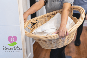 Cleaning lady holding laundry basket